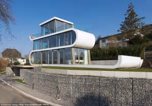 Glass Front House by Glass Fronted House Shaped Like A Ribbon Near Lake Zurich