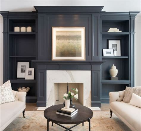 living room condo staging book wall and fireplace