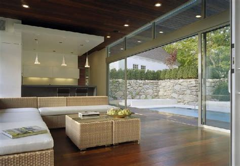 Living Room With Glass Wall by Living Room And Kitchen With Glass Wall Home Design And