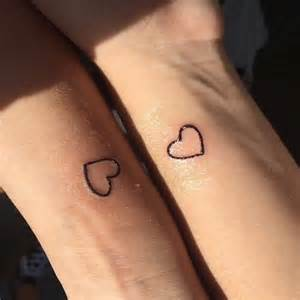 tiny couple tattoos tiny hearts design meaningful