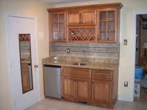 marvelous How To Put In Kitchen Cabinets #4: Wet-Bar-Cabinets-for-a-Perfect-Spot-in-Your-Kitchen-with-white-door.jpg