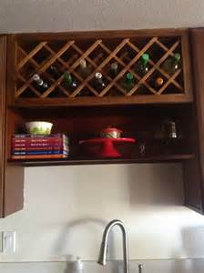 above the sink shelf and wine rack for the home