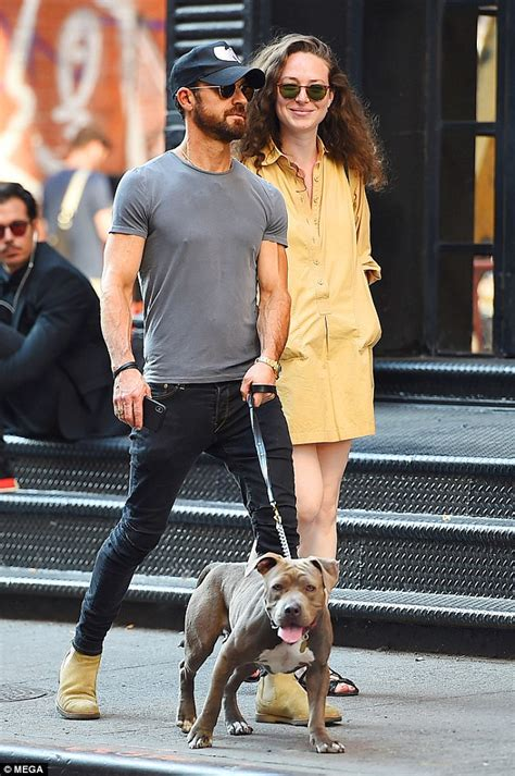 justin theroux dog justin theroux enjoys a stroll with mystery brunette as he