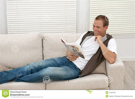 relaxing on the couch happy man relaxing on sofa royalty free stock images