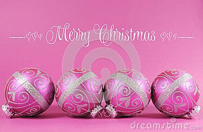 beautiful fuchsia pink festive bauble ornaments  sample text stock photo image