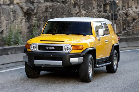 Toyota Fj Jeep by Comparison Toyota Fj Cruiser 2015 Vs Jeep Grand