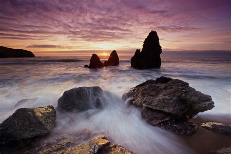 Rodeo Beach by Vibrant Sunset And Crashing Surf At Rodeo Beach Sausalito