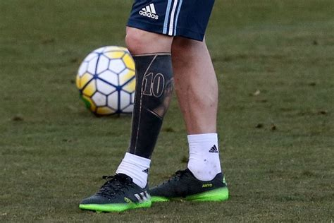 messi leg tattoo barcelona star leo messi gets huge new leg tattoo