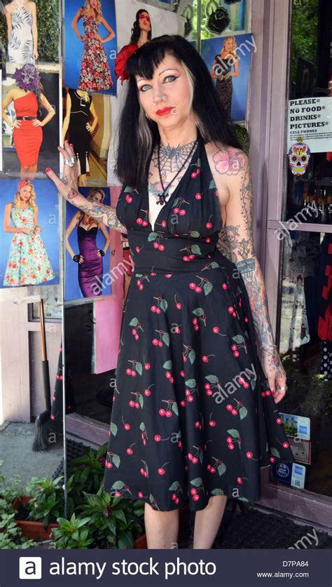 tattoo greenwich village nyc woman with tattoos and 1950 s style dress in greenwich