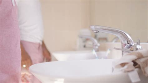 bathroom pov pouring water out of a filtered water faucet stock footage