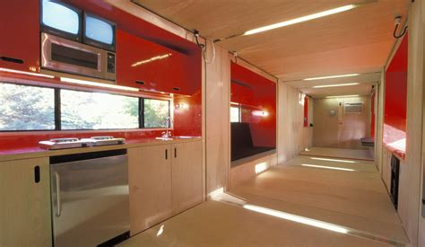 interior of shipping container home that slides out built