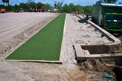 diy backyard putting green driviing range under construction
