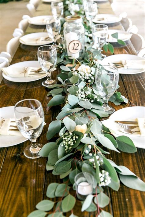 table decor long feasting table with garland greenery centerpieces and