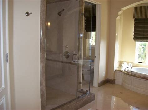bathroom with separate shower and bathtub shower door and separate tub