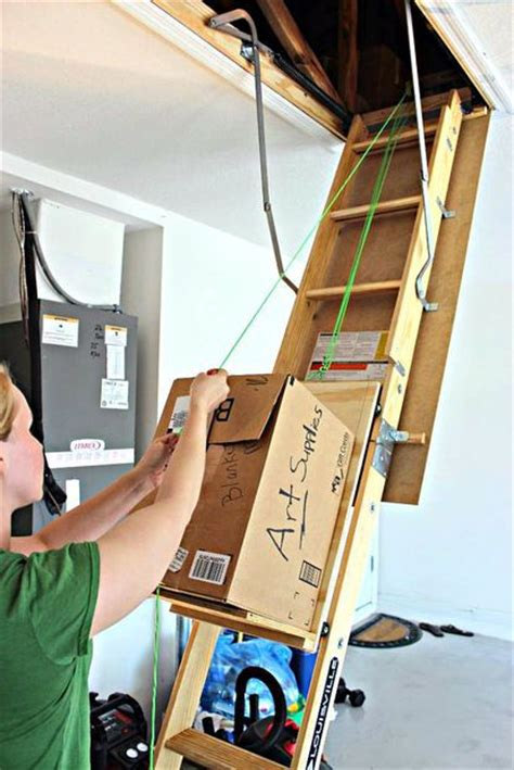 Garage Pulley Storage System by Diy Attic Storage Assistance It Works Ties And Pulley