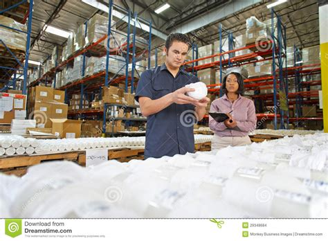 Factory Manager by Factory Worker And Manager Checking Goods On Production Line Stock Images Image 29348684