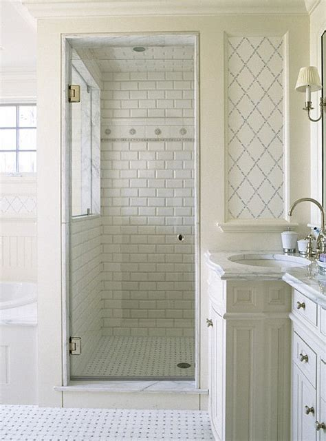 white subway tile walk in shower basketweave marble floor shower enclosure and frosted glass window separate tub bathroom