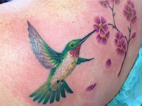 tattoo bangor maine hummingbird and flower by abby lusk of diversified