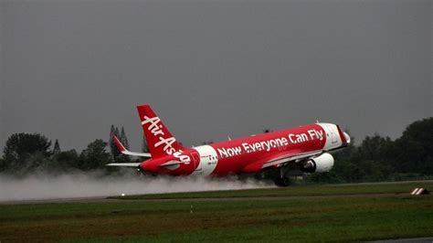 airasia emergency descent indian man attempts to open plane s emergency door while