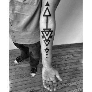 guy getting triangle tattoo on forearm ideas tattoo triangle tattoo meaning symbolism
