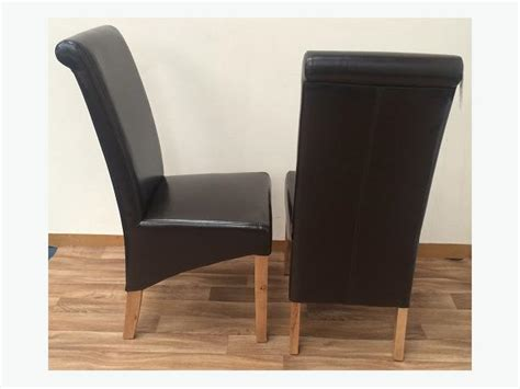 Brown Leather Dining Room Chairs Sale by Pair Of Rollback Leather Dining Chairs Available In
