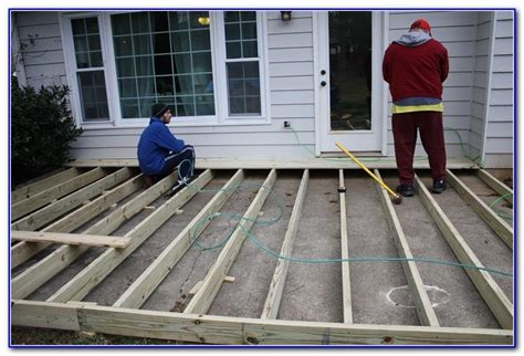 Installing Wood Deck Concrete Patio by Wooden Deck Concrete Patio Decks Home Decorating