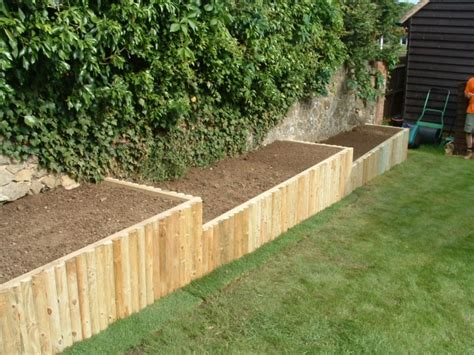 Raised Garden Border Ideas Heath Raised Beds Wooden Frame Faced With Wooden Poles Raised Planter Pinterest