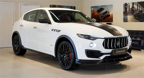 maserati levante white larte design shows its shtorm kit on a white maserati