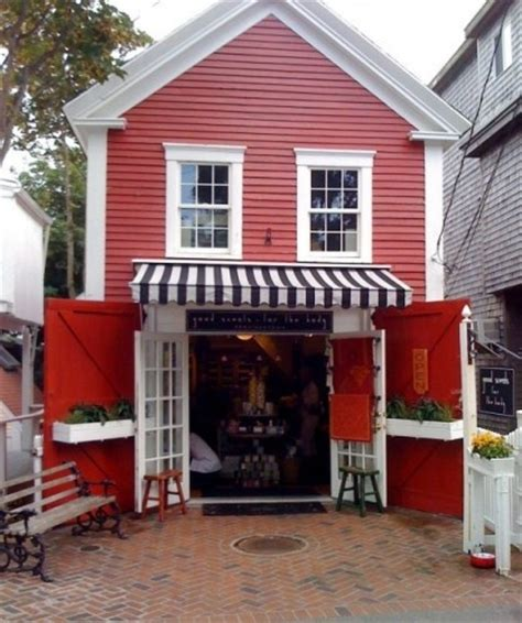 store front awning french doors barn doors window boxes on said barn