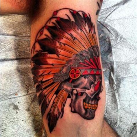 skull in headdress priest aztec on shoulder colorful skull in an indian headdress on arm