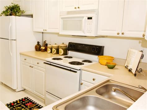 white appliances in kitchen kitchen remodeling where to splurge where to save hgtv