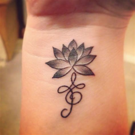 tattoos symbolizing strength lotus flower for strength and zibu symbol meaning
