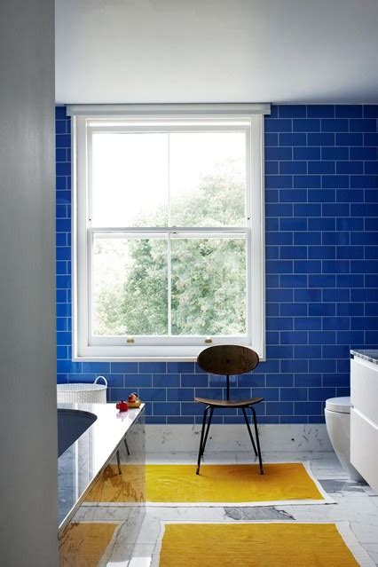 blue tiles yellow bathmats bathroom design ideas