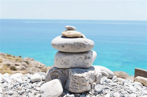 Balanced stack of stones over sea background   Our Great