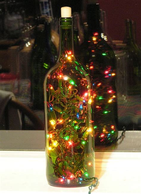 large green wine bottle light with multi colored christmas