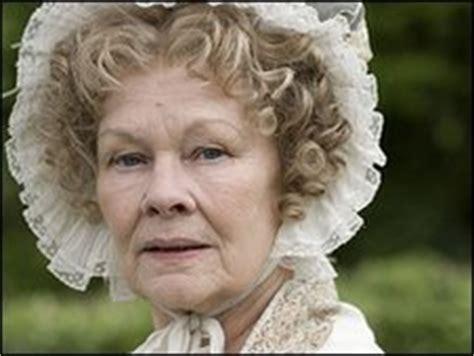dame judi dench teeth bbc news dame judi dench visits dentist in cranford costume