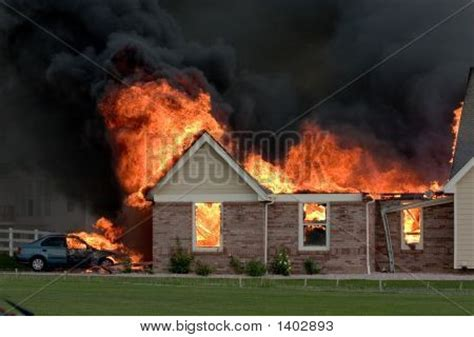 nasty house picture or photo of a nasty house fire caused by a lightning strike