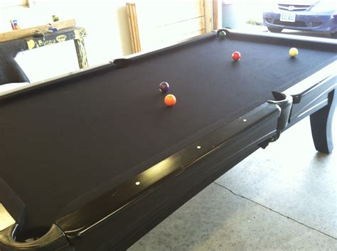 how much does it cost to move and refelt a pool table