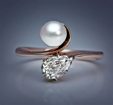 an pearl and bypass engagement ring made