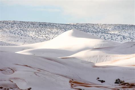 sahara snowfall cold weather conquers africa as a rare snow blanket