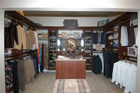 Artistic Closets master closet photo in cayenne maple from artistic closets