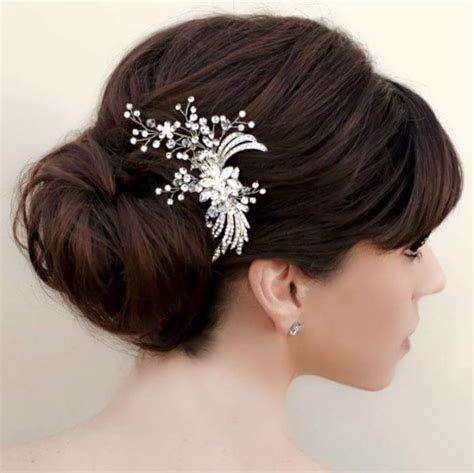 low bridal updo with soft bangs so pretty we this moncheribridals bridal hairstyles