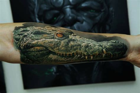 3d realistic head of crocodile forearm tattoo by dmitriy