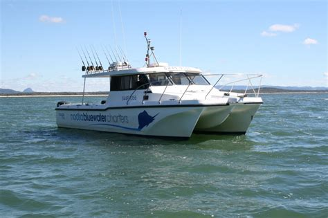 most stable fishing boat australia wide bodied twin hull cougar cat noosa blue fishing