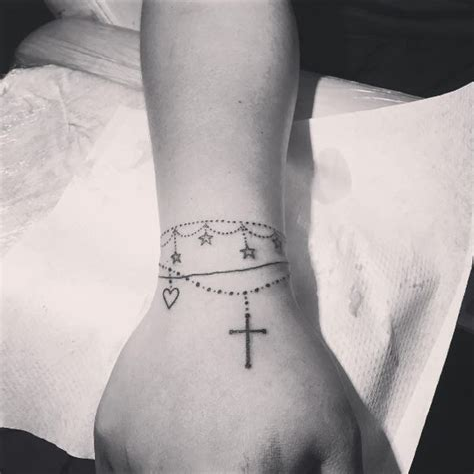 Cross Charm Tattoo