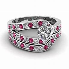 heart shaped loop pave diamond wedding ring with pink sapphire in 14k white gold