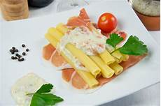 pasta candele italian pasta called candele with ham and cheese photo
