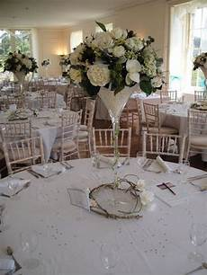 ivory wedding flower centrepiece martini vase and silk
