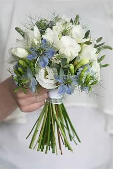 blue nigella bouquet with white freesia and white white lisianthus gomphrena wedding