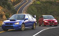 Subaru Or Evo by Car News And Reviews Subaru Wrx Vs Lancer Evo Battle